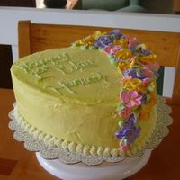 Hannah's Cake 1 Buttercream with royal icing flowers. My first real completed cake (other than Wilton Class cakes) for my daughters 1st birthday. My...