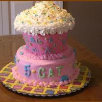 "Giant Cupcake Cake   Giant cupcake is sitting on a 2-layer 8"" cake. All buttercream."