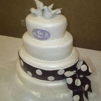 Oval Fondant Wedding Cake This was my first oval wedding cake. I covered it in Satin Ice, and used Super Pearl Luster Dust on it. The bride wanted and eggplant-...