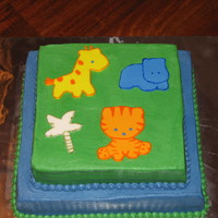 Baby Shower Cake WASC with raspberry filling. Fondant accents painted with gel food coloring to match the fabric in the baby's room.