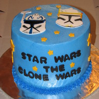 Star Wars Clone Wars Cake Chocolate cake with cream cheese filling. Fondant accents. The helmets on the top are painted with gel food coloring. TFL