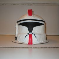 Star Wars Clone Trooper  We made this 6 layer cake for my son's 8th B-day. We used 6- 8in layers and carved it into the shape of the helmet and rice crispy...
