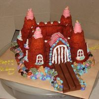 Princess Annika  This is a cake done for a friend and she wanted a castle out of a bundt pan she had. It was a little challenging to make it a princess...