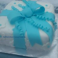 Blue Bow Cake Yellow cake, strawberry filling, fondant coverings. This cake was a gift to a little boy who has cancer, and his family.