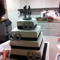 Western Wedding Traditional white wedding cake with buttercream frosting, horseshoes made from fondant