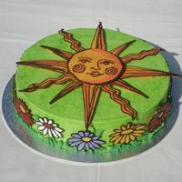 Summertime Sun Buttercream frosting and all chocolate/candymelt decorations.