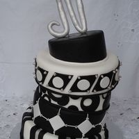 "Black And White All fondant decoration. The ""N"" is made out of modeling paste. I made it for my husbands birthday"