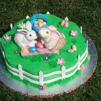 Bunny's Picknick The bunnies are made out of modeling paste, the fence and eggs out of gumpaste. Flowers are fondant