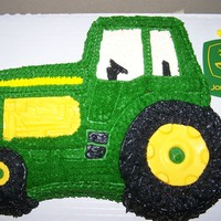 John Deer Tractor Tractor cake pan with chocolate accents.(wheels,etc)