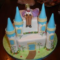 Castle And Prince Birthday cake for a boy who wanted a prince on his cake. The castle turrents are made from pastillage. The cake is covered with fondant,...