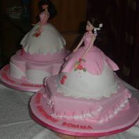 Sommie & Somma This cakes were made for two friends who share birthdays. They insisted on having doll cakes. The covering and decorations are fondant