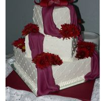 Burgundy Square Wedding 3 tier (5, 8, 12) BC with fondant drape. I couldn't get an impression mat in time, so the diamond pattern was made with some rulers....