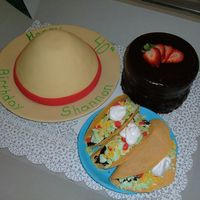 "Mexican Theme Cone of hat is Mexican chocolate cake/icing and it's covere din satin ice fondant, tacos are candy melts w/ crushed cookies, MMF ""..."