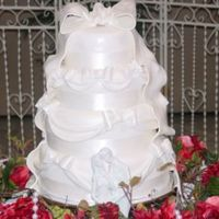 Bows & Swags Firwst wedding cake. All fondant bows and swags.