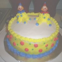 Clown_Cake.jpg This was my second cake using buttercream. I had troublle smoothing the edges where the white & yellow icing meet. But overall I think...