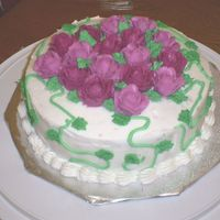 Rose_Cake.jpg  My intention was to cover the top of the cake with roses, but my hand started hurting. So, I just centered the roses and added vines to it...
