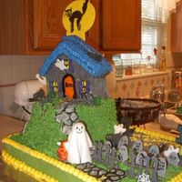 Halloween/haunted House This was a Halloween/50th birthday cake that I did for for my sister's surprise 50th birthday party. 1/2 sheet cake with rounds for...