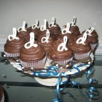 Wedding Shower Cupcakes These are chocolate cake with chocolate buttercream frosting and melted chocolate monograms on the tops. (There were also yellow cake with...