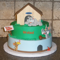 "Tom & Jerry 6"" roun inside of Spike's dog house, 10"" and 12"" rounds. The dog house is made from fondant panels. The characters are..."