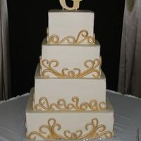Gold Fondant Scrolls On 4 Tier Square This cake was a pain!! Those scrolls took forever. Thanks for looking.