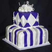 Fun Graduation Cake I made this purple and white and silver fun tiered fondant cake for a graduation cake. I sprayed it with my airbrush and pearl dust. I...