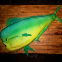 Dolphin Fish Groom's Cake A dolphin fish (mahi mahi) for an avid salt-water fisherman. The cake was red velvet (too funny)! Fondant with gumpaste fins, and...