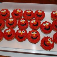 Elmo Cupcakes For my 2 year old's party at school. Red buttercream...I know, the parents were really happy with me!!! :) but the kids loved them!