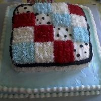 Baby Blanket   Buttercream frosting made to match baby blanket. Red, baby blue, white and dalmation print.