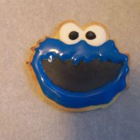 Cookie Monster Cookie I am making this as party favors for my nieces third birthday. This is my second time making cookies and first time with royal icing. They...