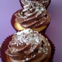 Photo.jpg Lamington cupcakes - vanilla cupcakes, whipped ganache icing and coconut.