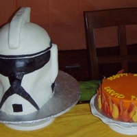 "Storm Trooper Helmet For my son's birthday. ""Helmet"" is vanilla cake, fondant and RCT accents. Round cake is covered in BCF with chocolate flames..."