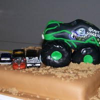 Grave Digger I used fondant icing and Rice Krispie Treat tires. Grave Digger was carved from a 9x13 with lots of extra cake left over. Yum.