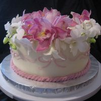 Orchids Cake Covered in BC and decorated with fresh flowers.