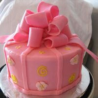 Pink Gift Cake Bow is made out of gumpaste, covered in BC icing.