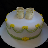 Baby Shower Covered in Fondant with fondant decorations and gumpaste booties.