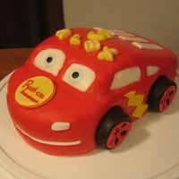 Lightning Mcqueen Covered in fondant with fondant accents.