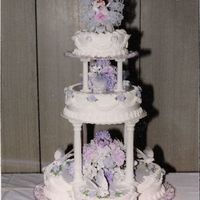 Lavendar Wedding Cake This wedding cake is Huge!!!...A total of 12 boxes of cake mix ,4 dozen eggs 12 pounds of confectioners sugar was used. It serves 242...