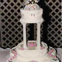"Pink Roses Wedding Cake This wedding cake has 4 - 10""(Bottom tier) 1-12"" (middle tier) and the tope tier is 1-8"" all double layered. Buttercream..."