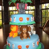 Safari Baby Shower Cake   Animals are all fondant, the cake is covered in MMF, very time consuming, but it was worth it....