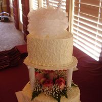 "Hearts 2 tier heart cake...both cakes white w/ straw. filling. Fresh flowers on bottom tier. 6"" & 9"" heart pans used."