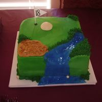 Golf Anyone? 8 x 8 mint choc. chip cake w/choc. mousse filling. Carved out small portion of cake to create waterfall. Used piping gel to give shine to...