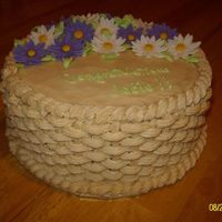 Sany8771Smaller.jpg The basketweave was done with tip 18. Fondant daisies.