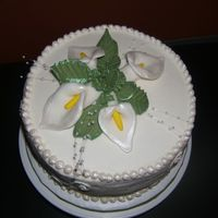 "Cala Lily 9"" Chocolate cake with buttercream. Cala lilies made from fondant. My first time using luster dust and I love it!"