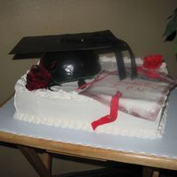 Graduation - Nurse This was made for a graduating nurse. The cap and the diplomo are decorated with fondant.