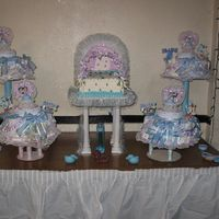 Stroller Cake With Diaper Cakes  This is a Stroller cake for a boy with diaper cakes surrounding it. I made this cake for one of my customer along with the diaper cakes...
