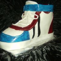 3-D Sneaker, Carlos Birthday Butter cake with BC frosting and filling covered in fondant. Colors gel mix with vanilla extract for the details. Inspired by Karen Nayak...