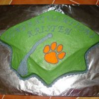 Graduation Cap W/ Clemson Paw This was for a high school graduation. The customer wanted the cap to be her high school colors and then a Clemson paw for the college she...
