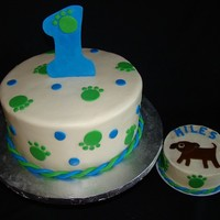 "Puppy 1St Birthday 10"" round covered in MMF with MMF/gumpaste accents. Smash cake is buttercream with MMF accents."