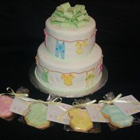 "Clothesline Baby Shower Cake Cake were 8"" and 6"", vanilla cake with cookies and cream filling. TFL"