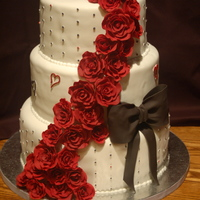 "Black Magic Roses Wedding Cake 12"", 10"", 8"" chocolate banana cakes with strawberry buttercream filling. The roses are 50/50 mix. The bride wanted black..."